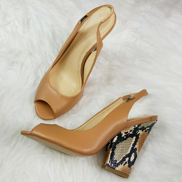 61d5e10892 Calvin Klein Shoes - Calvin Klein Caralee peep toe snakeskin heels